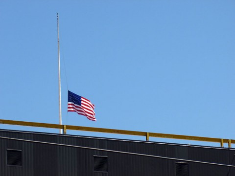 A Boston flag at half staff